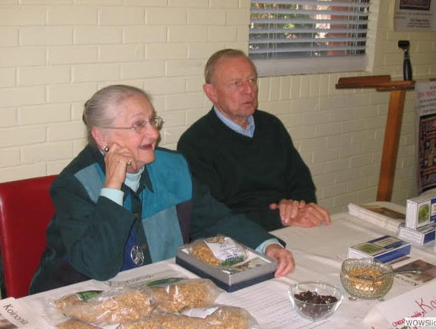 Carolyn and Cy King accept donations at a Marketplace of Meaningful Gifts table