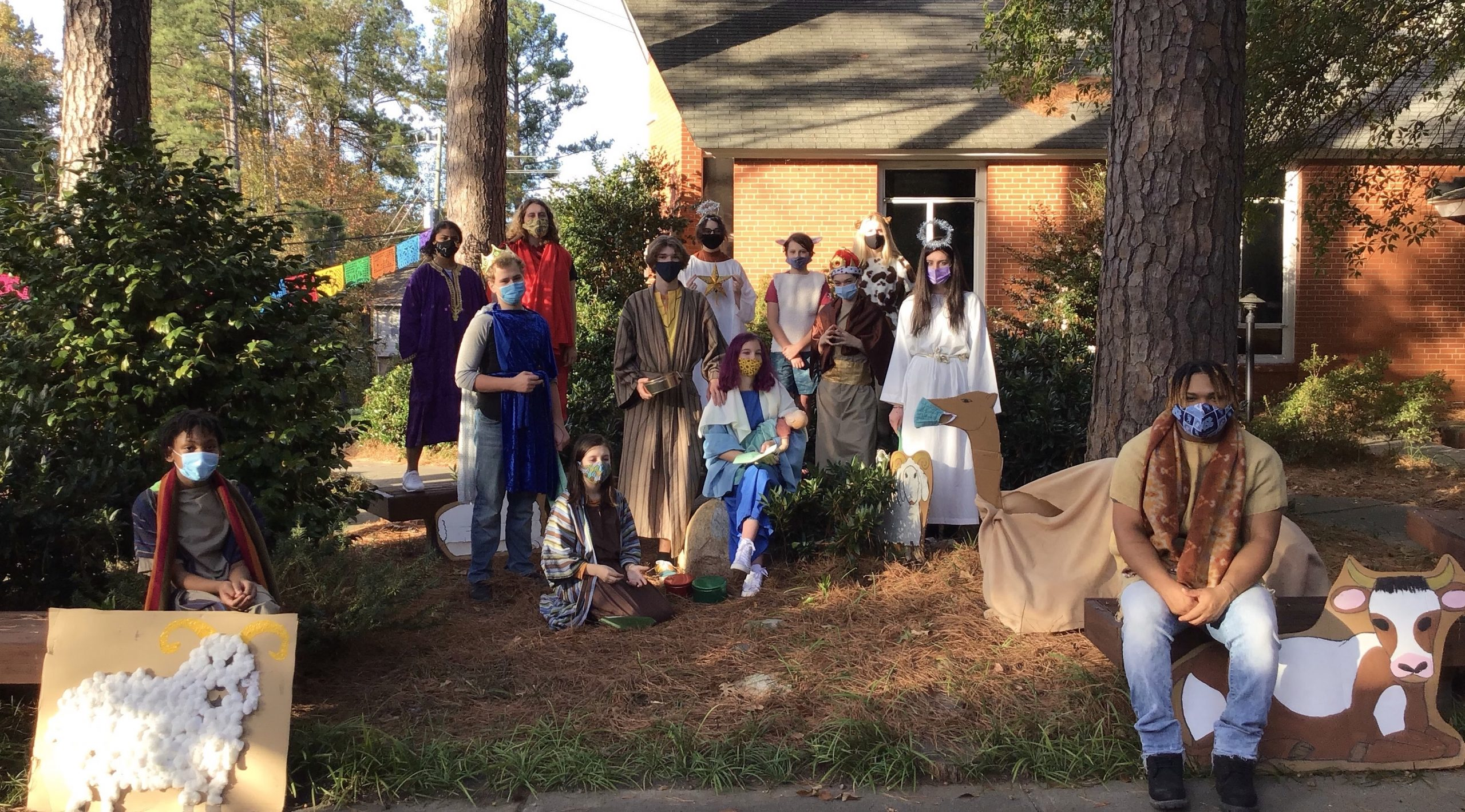 Youth in the courtyard in costume for the Christmas pageant