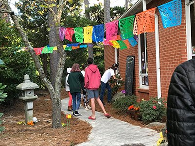 Youth remembering their ancestors in the Ofrenda in the Memorial Meditation Garden
