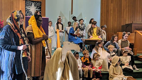 Children of all ages in costume perform the Christmas pageant