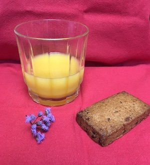 glass of orange juice and bread for communion