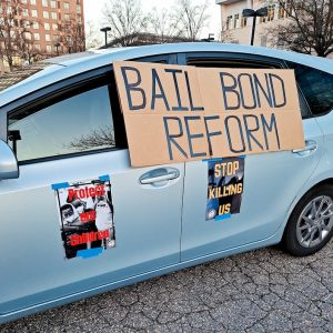 Car with signs for Bail Bond Reform